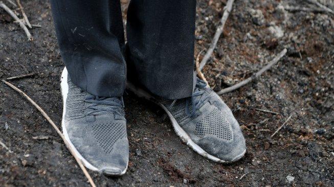 Cibir Jokowi yang Pamer Sepatu Kotor, Walhi Riau: Beliau Datang Bukan untuk Kotor-kotor, Penyelesaian Karhutla Bagaimana?